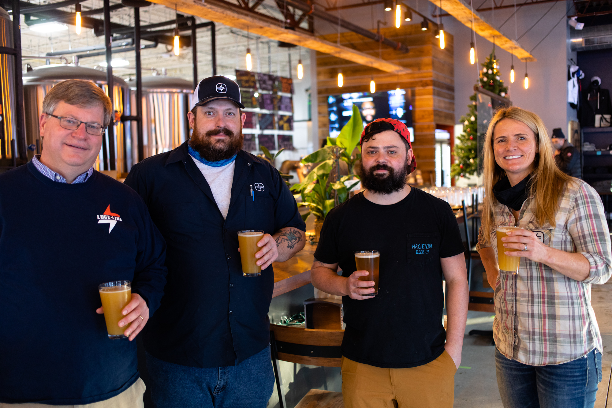 L to R: Luce Line co-founder and CEO Tim Naumann, taproom manager Todd Zallaps, head brewer Danny McMahon, and co-founder, COO, and CFO Kate Coward • Photo by Jordan Wipf